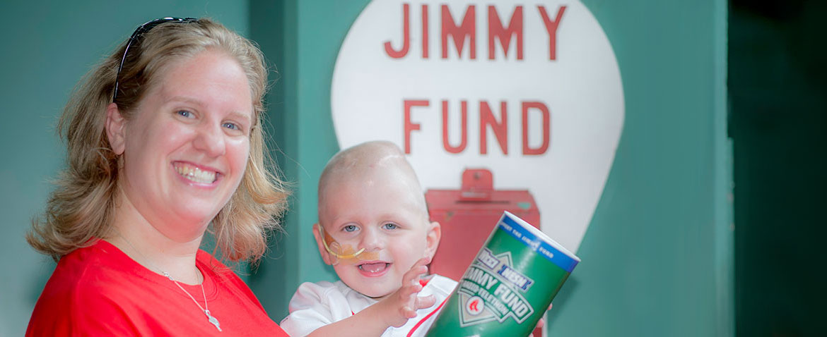 Dana-Farber Jimmy Fund Clinic patient, Conor, with his mom at Fenway Park