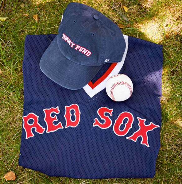 Red Sox jersey with baseball and Jimmy Fund baseball cap