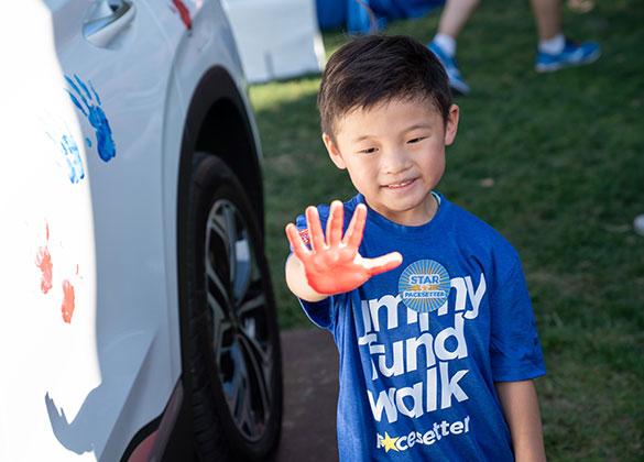Young walker showing his handprint