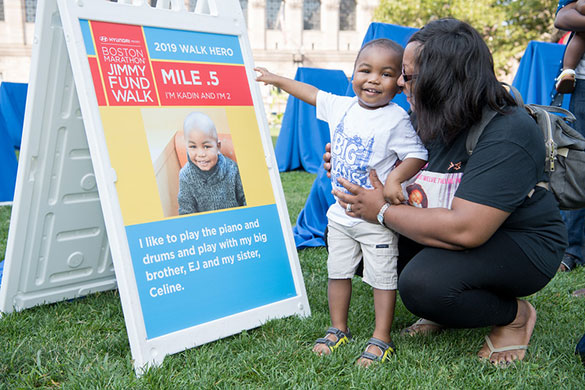 Jimmy Fund Walk Hero on the course with his mile marker
