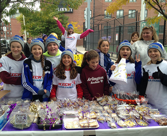 Team posing for a group photo at Kick for Dana-Farber bake sale
